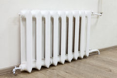 White iron radiator central heating is in room Stock Image