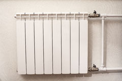 White iron radiator central heating in room Stock Image
