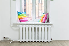White iron radiator of central heating under windowsill Stock Photography