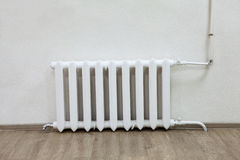 White iron radiator central heating on wall in room Royalty Free Stock Photos