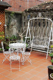 White iron tables and chairs Stock Photography