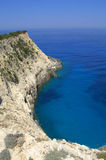 White island cliff in bright blue water Royalty Free Stock Photo