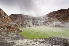 White Island, New Zealand. Active volcano off the coast of New Zealand, filled with steam vents and hot pools Stock Image