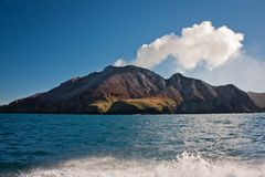 White Island in North Island of New Zealand. Aotearoa as maori name of country in Australasia, volcanic island with sulphur smoke, geologically young land royalty free stock photos