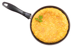 Spanish potato omelette in the frying pan Royalty Free Stock Photos