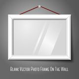 White isolated horizontal photo frame hanging on. Vector white isolated horizontal photo frame hanging on the wall, with glass Stock Photography