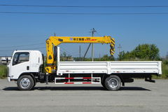 White Isuzu flatbed truck with yellow crane arm is in the parking lot - Russia, Moscow, 30 August 2016 Royalty Free Stock Images