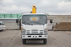 White Isuzu flatbed truck with yellow crane arm is in the parking lot - Russia, Moscow, 30 September 2016 Royalty Free Stock Photography