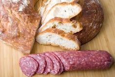 White Italian bread sliced with sausage sandwich. White Italian brick oven delicious fresh baked bread sliced with sausage for sandwich royalty free stock image