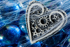 White ivory heart shape on blue crystals Stock Photography