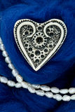 White ivory heart shape on blue woolen textile Royalty Free Stock Photography