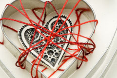 White ivory heart shape in thread cobweb Stock Image