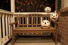 White jack o'lanterns on a bench Royalty Free Stock Photo