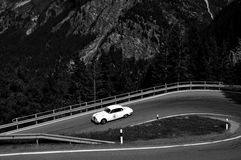 A white Jaguar S-Type. MALOJA PASS, SWITZERLAND - JUNE 14: A white Jaguar S-Type takes part to the Summer Marathon classic car race on June 14, 2014 near Maloja Royalty Free Stock Photos