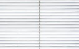 White jalousie. White light jalousie at a window Stock Photos