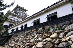 White Japanese castle with stone wall Stock Image