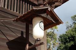 White Japanese paper lamp with black symbol of flower in front of the Todai-ji temple. stock image