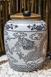 White jar with blue dragon painting Royalty Free Stock Images