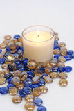 White candle with blue and gold beads Royalty Free Stock Photography