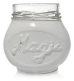 White jar hand-painted with the word magic. Stock Photos