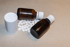 White jar of pills and two bottles of medical drugs royalty free stock photo