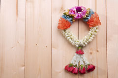 White jasmine garland. On wood background Stock Photography
