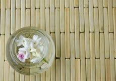 White jasmine in water bottle Royalty Free Stock Photos