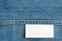 White jeans tag. White jeans texture tag close up. Horizontal jeans background with stitches Stock Photos