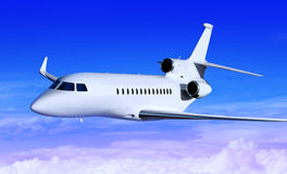 White jet. Private white jet plane in the blue sky Royalty Free Stock Photo