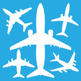 White jet airliners in the air Royalty Free Stock Photography