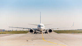 White jet airplane on the runway Stock Photography