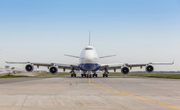 White jet airplane on the runway Royalty Free Stock Photo