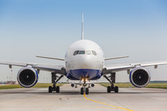 White jet airplane on the runway Stock Image