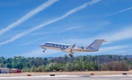 White Jet Taking Off Stock Photo