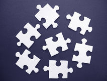 White jigsaw. On a blue background stock illustration