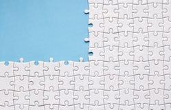 White Jigsaw Blue Background Stock Images