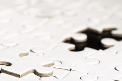 White jigsaw over black Stock Image