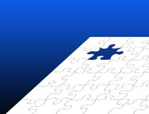 White jigsaw over blue Royalty Free Stock Photography