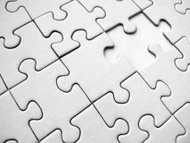 White jigsaw pieces. White jigsaw background (conceptual royalty free stock photos