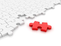 White Jigsaw pieces - One Red Stock Photography