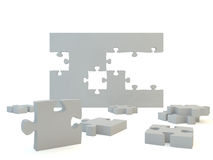 White Jigsaw Puzzle. Thick white jigsaw puzzle pieces falling, isolated Royalty Free Stock Image