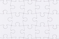 White jigsaw puzzle. As a background Stock Photography