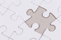 White jigsaw puzzle. As a background Stock Images