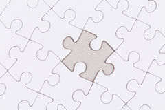 White jigsaw puzzle. As a background Royalty Free Stock Photo