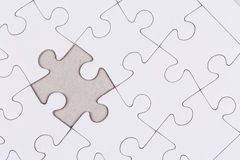 White jigsaw puzzle. As a background Stock Photos