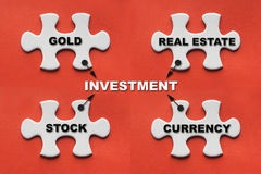 White jigsaw puzzle with investment concept or investment plan Stock Photography