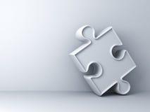 White jigsaw puzzle piece on white wall Stock Photo