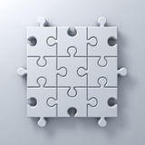 White jigsaw puzzle pieces concept on white wall background with shadow Stock Image