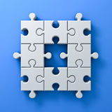 White jigsaw puzzle pieces one missing concept on blue wall background with shadow 3D render. White jigsaw puzzle pieces one missing concept on blue wall Stock Photos