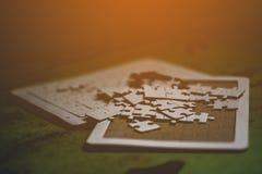 White jigsaw puzzle teamwork And harmony. Teamwork And harmony teamwork And harmony Stock Images